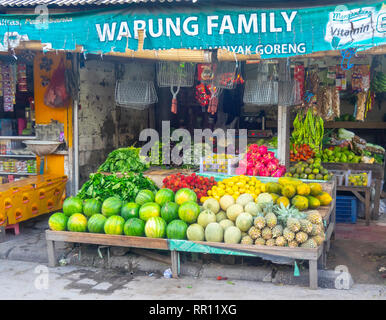 Shop in markets selling fruit, melons, dragon fruit, paw paw, pineapples, in Jimbaran Bay Bali Indonesia. - Stock Photo