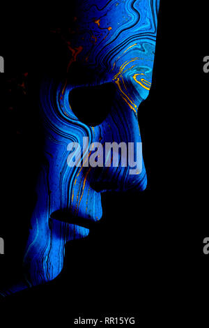Robot blue face mask side view close up with contoured textured skin and blank eyes. Black background and space for text. Artificial intelligence conc - Stock Photo