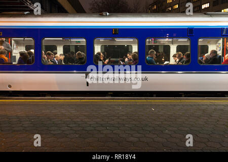Rail commuters on a busy Chiltern railways train at London Marylebone in the evening rush hour waiting to depart - Stock Photo