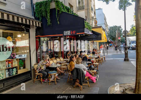 People sitting outside at Cafe du Marche des Enfants Rouges, Rue de Bretagne,Paris - Stock Photo