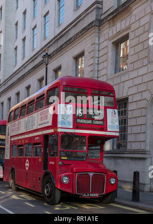 Old style heritage Routemaster double decker bus driving a reduced service between Trafalgar Square and Tower Hill, London from March until September. - Stock Photo