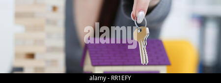 Female hand holds the key to the lock in - Stock Photo
