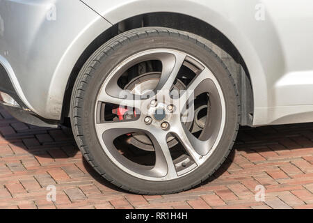 brake disc and the wheel and tire of an Alfa Romeo car - Stock Photo