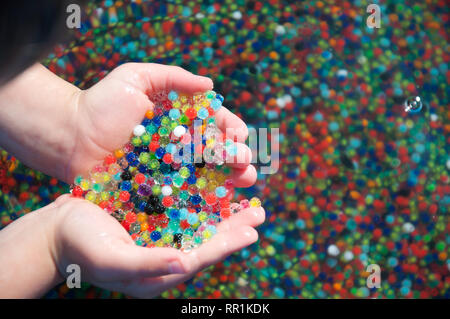 Water beads held in a hand - Stock Photo