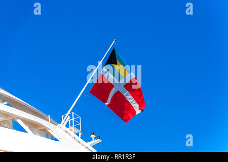 The Flag of Bahamas Registry flying on a cruise ship - Stock Photo