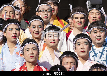 Tokyo, Japan. 24th Feb, 2019. Participants dressed in women's kimonos and wearing makeup, pose for a group photo during the Ikazuchi no Daihannya festival in the Shinzoin Temple. Festival volunteers carry 6 containers from the Shinzoin Temple around the neighborhood to chase away evil spirits.The origins of this annual event are disputed, but the legend tells the priest of Shinzoin Temple visited house to house to prevent the spread of cholera during the late Edo era. Another legend of a man who lived in the neighborhood dressed in women's kimono to scare away the bad spirits for his si - Stock Photo