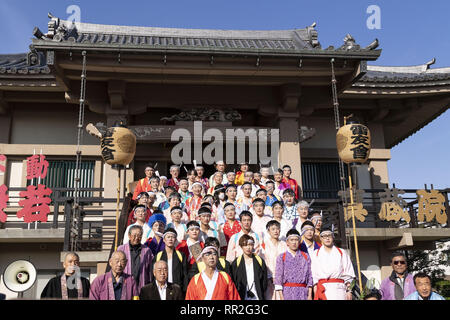 Tokyo, Japan. 24th Feb, 2019. Participants dressed in women's kimonos and wearing makeup, pose for a group photo during the Ikazuchi no Daihannya festival in the Shinzoin Temple. Festival volunteers carry 6 containers from the Shinzoin Temple around the neighborhood to chase away evil spirits. The origins of this annual event are disputed, but the legend tells the priest of Shinzoin Temple visited house to house to prevent the spread of cholera during the late Edo era. Another legend of a man who lived in the neighborhood dressed in women's kimono to scare away the bad spirits for his si - Stock Photo