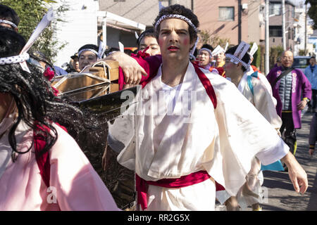 Tokyo, Japan. 24th Feb, 2019. A foreigner from Australia dressed in women's kimonos and wearing makeup, takes part during the Ikazuchi no Daihannya festival. Festival volunteers carry 6 containers from the Shinzoin Temple around the neighborhood to chase away evil spirits. The origins of this annual event are disputed, but the legend tells the priest of Shinzoin Temple visited house to house to prevent the spread of cholera during the late Edo era. Another legend of a man who lived in the neighborhood dressed in women's kimono to scare away the bad spirits for his sister who was sufferin - Stock Photo