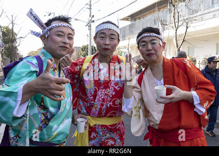 Tokyo, Japan. 24th Feb, 2019. Participants dressed in women's kimonos and wearing makeup, pose for a photograph during the Ikazuchi no Daihannya festival. Festival volunteers carry 6 containers from the Shinzoin Temple around the neighborhood to chase away evil spirits.The origins of this annual event are disputed, but the legend tells the priest of Shinzoin Temple visited house to house to prevent the spread of cholera during the late Edo era. Another legend of a man who lived in the neighborhood dressed in women's kimono to scare away the bad spirits for his sister who was suffering f - Stock Photo