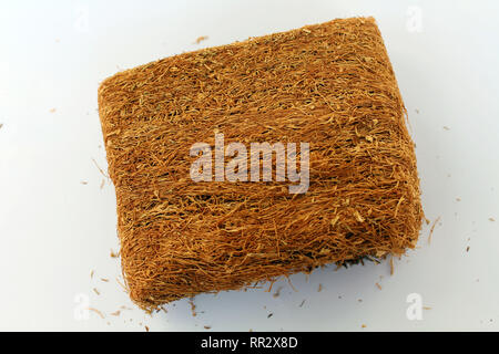 A slice of pressed tobacco that grows in Indonesia. A closeup view. - Stock Photo