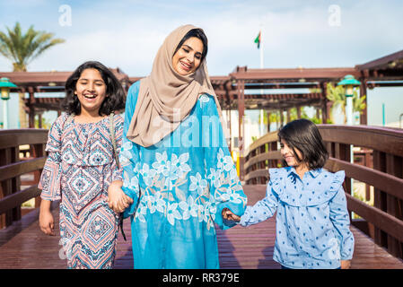 Happy arabian family having fun in Dubai - Mom together with her daughters - Stock Photo