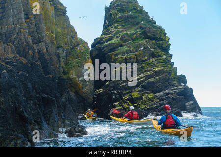 Sea Kayaking along the Solway coast from Carrick to Manx Mans rock, Dumfries & Galloway, Scotland - Stock Photo