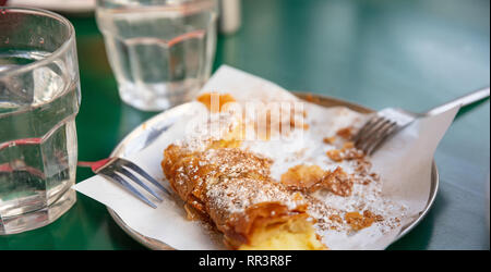 Bougatsa, greek traditional cream pastry served with sugar and cinnamon garnish - Stock Photo