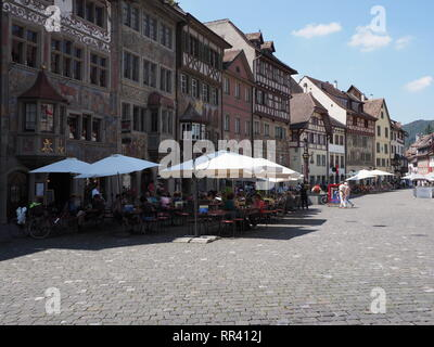 STEIN am RHEIN, SWITZERLAND on AUGUST 2018: View to old houses at street on main market square in swiss european town at Schaffhausen canton with clea - Stock Photo