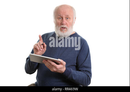 Funny old man using tablet computer isolated on white - Stock Photo