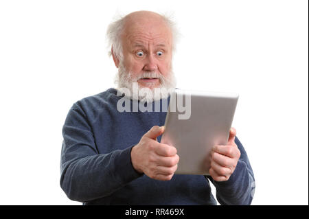 Funny shocked old man using tablet computer isolated on white - Stock Photo
