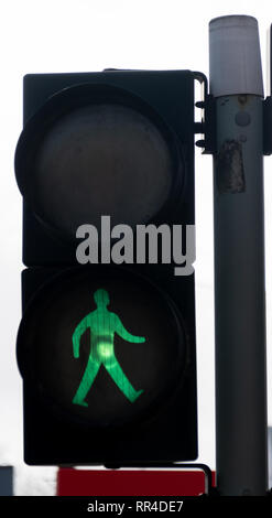 Reading, United Kingdom - February 09 2019:   Pelican crossing sign showing green man for safe to cross on Caversham Road - Stock Photo
