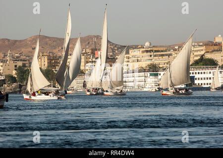Aswan, Egypt - April 17 2008: Feluccas - traditional egyptian boat  on Nile river, Egypt. - Stock Photo