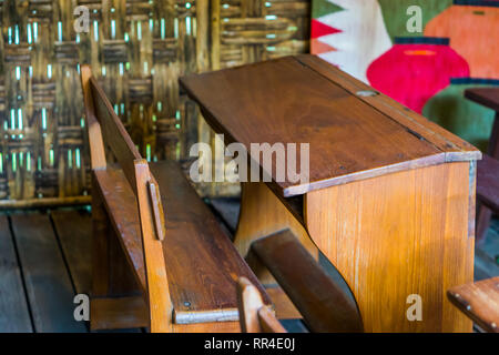 Old wooden school bench in a class room, Third world education furniture - Stock Photo