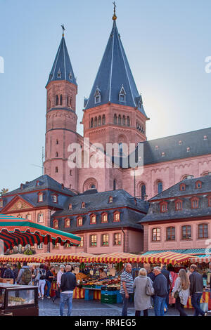 Mainz, Germany - October 13, 2018: weekly market on the market place in front of St. Martins cathedral, Dom in Mainz, Germany - Stock Photo