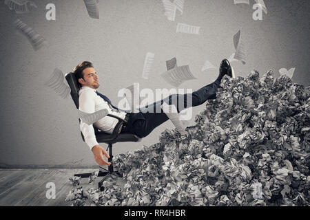 Businessman with paper sheet anywhere. Buried by bureaucracy. Concept of overwork - Stock Photo