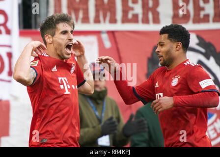 Munich, Germany. 23rd February, 2019. Javi MARTINEZ, FCB 8 celebrates his goal for 1-0 , happy, laugh, celebration, Serge GNABRY, FCB 22  FC BAYERN MUNICH - HERTHA BSC BERLIN 1-0  - DFL REGULATIONS PROHIBIT ANY USE OF PHOTOGRAPHS as IMAGE SEQUENCES and/or QUASI-VIDEO -  1.German Soccer League , Munich, February 23, 2019  Season 2018/2019, matchday 24, FCB, München,  © Peter Schatz / Alamy Live News - Stock Photo
