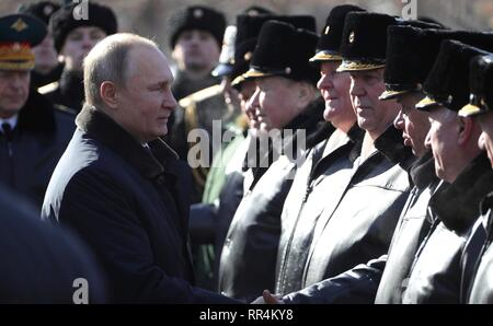 Moscow, Russia. 23rd Feb, 2019. Russian President Vladimir Putin greets veterans during a wreath ceremony at the Tomb of the Unknown Soldier at the Kremlin Wall to honour the memory of fallen soldiers on Defender of the Fatherland Day February 23, 2019 in Moscow, Russia. Credit: Planetpix/Alamy Live News