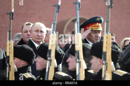 Moscow, Russia. 23rd Feb, 2019. Russian President Vladimir Putin and Defence Minister Sergei Shoigu, right, attend a wreath ceremony at the Tomb of the Unknown Soldier at the Kremlin Wall to honour the memory of fallen soldiers on Defender of the Fatherland Day February 23, 2019 in Moscow, Russia. Credit: Planetpix/Alamy Live News