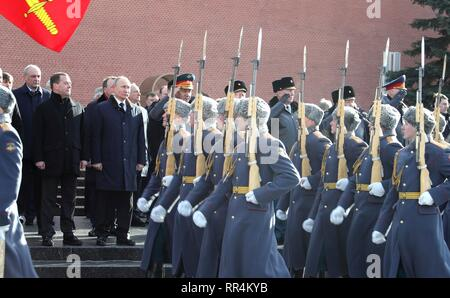 Moscow, Russia. 23rd Feb, 2019. Russian President Vladimir Putin and Prime Minister Dmitry Medvedev attend a wreath ceremony at the Tomb of the Unknown Soldier at the Kremlin Wall to honour the memory of fallen soldiers on Defender of the Fatherland Day February 23, 2019 in Moscow, Russia. Credit: Planetpix/Alamy Live News