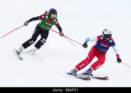 Miass, Russia. 24th Feb, 2019. CHELYABINSK REGION, RUSSIA - FEBRUARY 24, 2019: Athletes India Sherret (L) of Canada and Sanna Luedi of Switzerland compete in the ladies' ski cross semifinal event of the 2018/19 FIS Freestyle Ski World Cup held at the Sunny Valley ski base in Miass. Donat Sorokin/TASS Credit: ITAR-TASS News Agency/Alamy Live News - Stock Photo