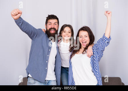 Reunited and it feel so good. Father, mother and happy child at home. Family day. Happy family. Little girl love her parents. Bearded man and woman with daughter. Childrens day. happy childhood. - Stock Photo