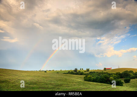 Scenic view of Central Kentucky countryside with double rainbow after storm - Stock Photo