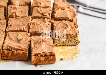 Vegan square cake with cocoa cream. Healthy plant based food concept. - Stock Photo