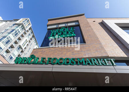 OTTAWA, CANADA - NOVEMBER 12, 2018:  Whole Foods Market logo on their main store for Ottawa, Ontario.  Whole Foods market is an American brand of supe - Stock Photo