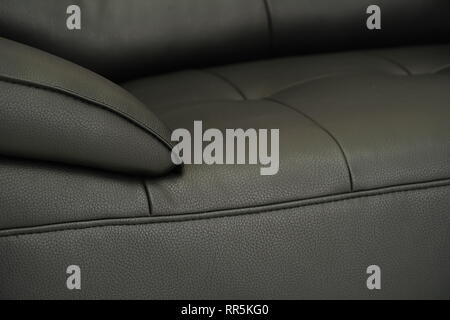 Black grey fabric sofa, close up detail with buttons - Stock Photo