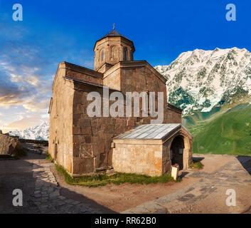 Pictures & images of Gergeti Holy Trinity (Tsminda Sameba) Georgian Orthodox and Apostolic Church, 14th century, Gergeti, Khevi province, Georgia (cou - Stock Photo