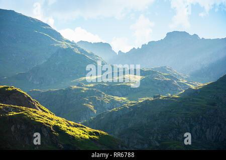 fagaras mountain ridge in the morning. rocky formations in sunlight. beautiful summer scenery - Stock Photo