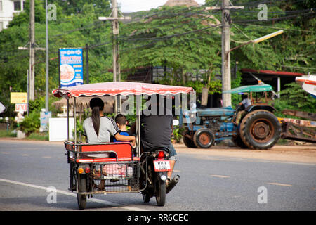 Thai people riding and driving on the road at Ban Phe village city on July 4, 2018 in Rayong, Thailand - Stock Photo