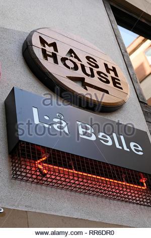 Signs for club Mash House and La Belle Angele, Edinburgh Scotland - Stock Photo