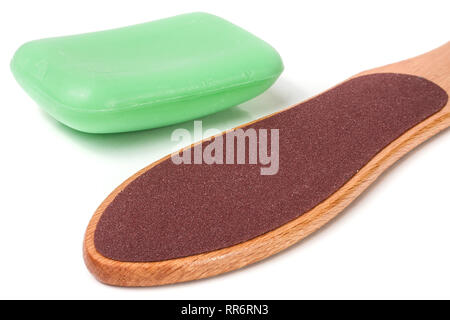 wooden double-sided grater for feet with soap isolated on white background - Stock Photo