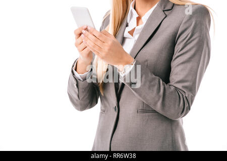cropped view of businesswoman using smartphone isolated on white - Stock Photo