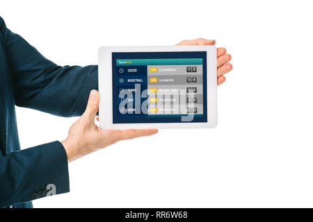 cropped view of businessman showing digital tablet with sports app, isolated on white - Stock Photo