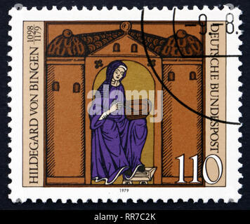 GERMANY - CIRCA 1979: a stamp printed in the Germany shows Hildegard von Bingen with Manuscript, Benedictine Nun, Mystic and Writer,  circa 1979 - Stock Photo