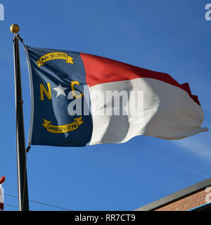 Flag of the state of North Carolina flapping in the wind. - Stock Photo