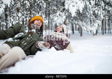 Couple Playing in Snow - Stock Photo