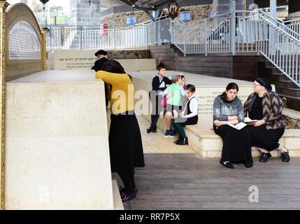 Jewish pilgrims pray at the Tomb of Maimonides in Tiberias, Israel. - Stock Photo