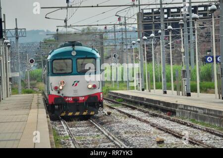 Italian train at Empoli station - Stock Photo
