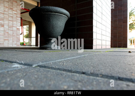 Decorative urn ashtray placed outside of an office building for smokers; exterior designated smoking area; Bryan, Texas, USA. - Stock Photo