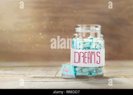 Dream house concept. Dreams jar. Full glass jar of cherished wishes - Stock Photo