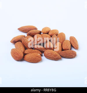 nuts almonds isolated on white background. Selective focus. - Stock Photo